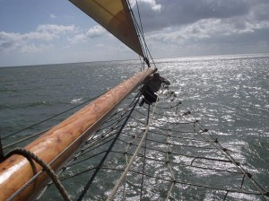 Denis Johnson perched at the end of the Bowsprit taken by Dave Brooks