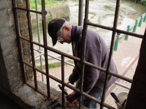 Purifier Building. Restoring iron window frames; Picture from Faversham Creek Trust website
