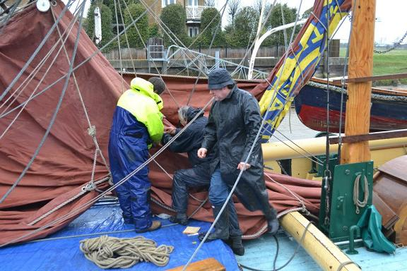 Sail-maker Steve Hall helps rig the Cambria March 2013