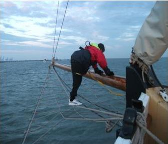 Rick Martin clambers out along the Bowsprit Net